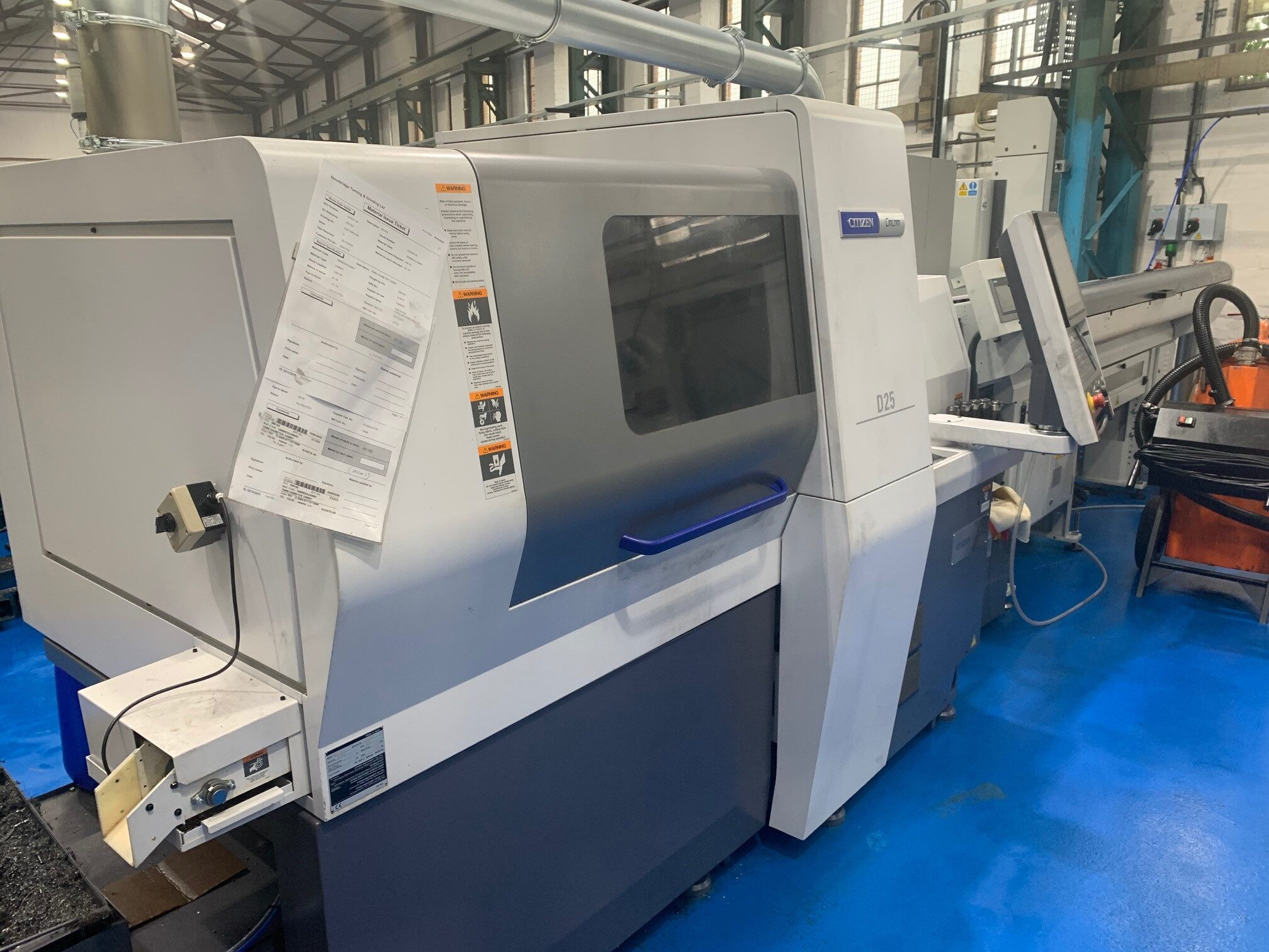 Preowned D25-VIII 12 axis CNC Sliding Headstock Turning Centre
